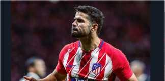 Diego Costa merayakan golnya ke gawang Sevilla, Kamis dinihari, namun Atletico Madrid akhirnya kalah 2-1