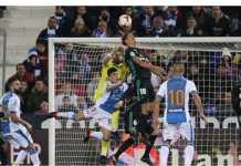 Marcos Llorente (No 18) menyundul bola yang menghantam mistar gawang Real Madrid. Hampir saja memberi gol bunuh diri bagi keuntungan Leganes pada laga perempat final Copa del Rey, Jumat dinihari.