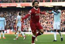 Mohamed Salah merayakan golnya bagi Liverpool pada laga Liga Inggris, Sabtu 24 Februari 2018, melawan West Ham United.