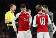 Arsenal harus membayar mahal kemenangan mereka singkirkan AC Milan di babak 16 besar Liga Europa, dengan kehilangan Laurent Koscielny yang alami cedera saat laga baru berjalan 10 menit.