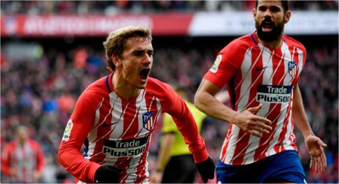Striker Atletico Madrid Antoine Griezmann merayakan golnya ke gawang Celta Vigo pada laga LIga Spanyol, Minggu malam.