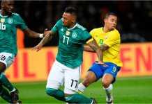 Gabriel Jesus mengecoh dua pemain Jerman saat Brasil tandang ke tim juara dunia itu, Kamis dinihari WIB.