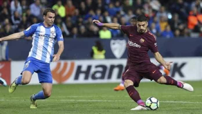 Luis Suarez dipastikan absen dalam pertandingan melawan Athletic Bibao pekan depan, setelah ia menerima kartu ke lima di musim ini dalam laga di kandang Malaga, Minggu (11/3) dinihari tadi.