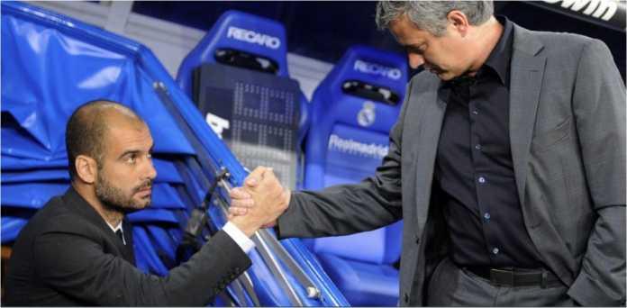 Dua rival terbesar di dunia kepelatihan Liga Inggris, Pep Guardiola dan Jose Mourinho, berjabatan tangan satu sama lain.