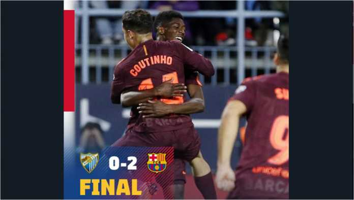 Philippe Coutinho dan Ousmane Dembele merayakan gol kedua Barcelona di gawang Malaga, Minggu dinihari WIB.
