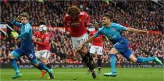 Pemain Belgia Marouane Fellaini menanduk bola untuk menjadi gol kemenangan Manchester United 2-1 atas Arsenal pada laga Liga Inggris, Minggu malam.