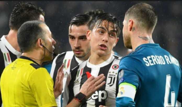 Sergio Ramos nodai kemenangan Real Madrid d kandang Juventus dengan larangan bermain di leg ke dua pekan depan.