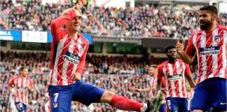 Antoine Griezmann merayakan satu gol Atletico Madrid bersama Diego Costa