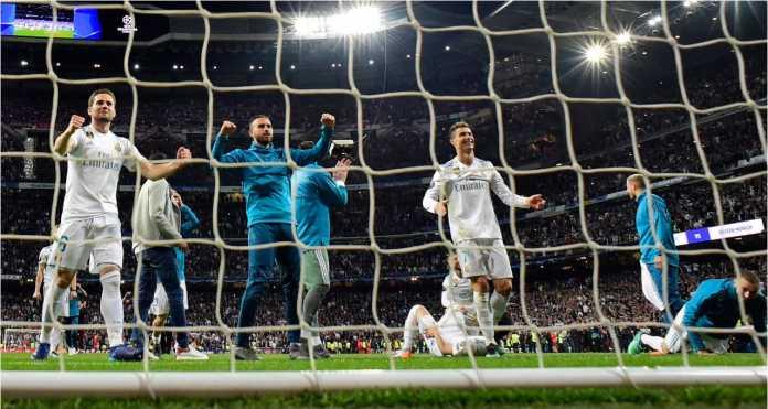 Para pemain Real Madrid merayakan keunggulan agregat 4-3 mereka atas Bayern Munchen di leg kedua semifinal Liga Champions, Rabu.