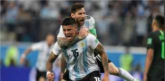 Lionel Messi merayakan gol Marcos Rojo pada laga melawan Nigeria. Argentina diramalkan bertemu Portugal pada babak perempat final.