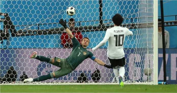 Mohamed Salah menjebol gawang Rusia pada akhir babak kedua laga Piala Dunia 2018 lawan Mesir, Rabu dinihari. Tapi satu gol ternyata tidak mencukupi.