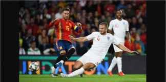 Eric Dier menjatuhkan Sergio Ramos dalam satu adegan laga Spanyol vs Inggris di UEFA Nations League, Selasa dinihari